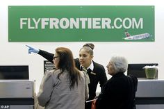 Frontier Airlines workers at Cleveland-Hopkins International Airport wore latex gloves on ...
