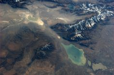 """Was fascinated by this so looked it up: The Dzungarian Gate, mountain pass between China & Kazakhstan. The smaller lake, Ebinur, on top of the picture, is located in China. Earth And Space Science, Earth From Space, Hubble Pictures, Remote Sensing, Space Time, Our Solar System, Local Events, To Infinity And Beyond, Planet Earth"