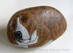 Dog with brindle fur painted on a rock
