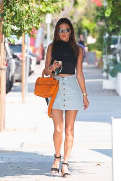 While out in Los Angeles, the model and VS Angel channels the '70s in a button-front A-line denim skirt, available at American Apparel for $62.    - HarpersBAZAAR.com