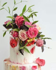 """♡""""My clients often inspire me! I channeled the bride's favorite artist, Cy Twombly, in romantic, abstract handpainted floral tiers.""""  Thanks to @maggieaustincake for taking over our account on this special #cakeweek edition of #takeovertuesday. Check out her account for more beautiful creations  #theknot #theknotcakes  + Cake by @maggieaustincake"""