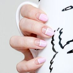pink and white negative space nail art