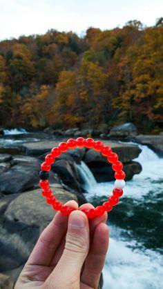 @gitranegie |Lokai will donate $1.00 to Save the Children for each red lokai bracelet sold in December.|