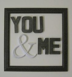 "DIY ""You & Me"" sign wall decor...made using cardboard letters, paint, and frame.  There is no backing to the frame...just hang on the wall."