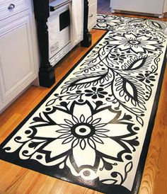 She turns flooring vinyl upside down and paints on the felted surface underneath with gesso and then acrylic paints.