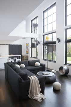 Leo Designs Chicago - living rooms - black and white living room, black sectional, black slipcovered sectional, linen throw, round pillow,