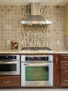 Contemporary Kitchen Design With Beautiful Backsplash Behind Stove: Amazing Backsplash Behind Stove With Marble Countertops And Range Hood For Contemporary Kitchen Design Ideas