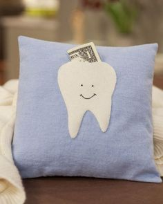 Tuck teeth awaiting pickup by the tooth fairy into this adorable, simple-to-sew pillow.