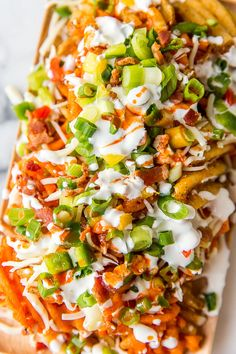 Get ready for the biggest day in football with these crazy good, loaded french fry nachos. It will quickly become your favorite Super Bowl recipe!