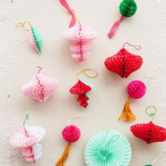 Make your own honeycomb ornaments! See how on ohhappyday.com.