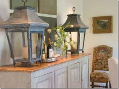 Rethink your small accessories and collections – instead put out a few oversized pieces, like these matching lanterns.