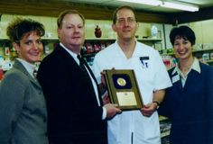 Bill Drilling accepts an award on behalf of Drilling Pharmacy for fill 1 million prescriptions.