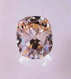"This diamond was named Star of the South (""Estrella do Sud""). It is a 128.48-carat, cushion-shaped stone, with a clarity of VS2, and color grading of fancy light pinkish brown"