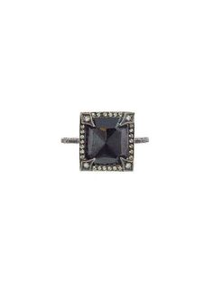 square, rose cut, black diamond that totals 4.29 carats. It rests on a thin, pave diamond band.