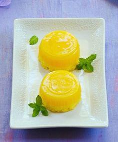"QUINDIM-  (pronounced keen-DEEN) Brazilian custard with a coconut ""crust."" It is sunshine on a plate!"