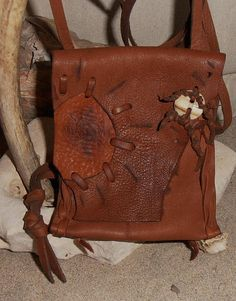 Love this natural, free spirited leather bag. A great transition for fall.