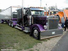 Purple Peterbuilt 379 with a grain trailer.