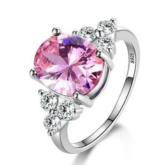 These beautiful sterling silver and zircon rings feature a bright oval-shaped zircon gemstone as the centerpiece embellished with three clear zircons on either side of the oval. Perfect for everyday wear or to dress up for an evening out. Use E Abuse, Sterling Silver Wedding Rings, Stamp, Or, Gemstone Rings, Women Jewelry, Gemstones, Oval Shape, Size Chart