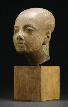 A fine sand stone head, Egypt, possibly depicting Maket-Aton, a daughter of Echnaton and Nofretete. From an old German private collection, purchased between 1920's and 1940's. Small damages to the nose, the mouth and the ears. Rubbing. Wooden base.