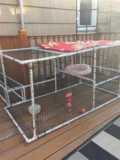 Catio ~ made out of pvc piping, mesh netting and zip ties. Cats think they are in heaven going in and out all day long~