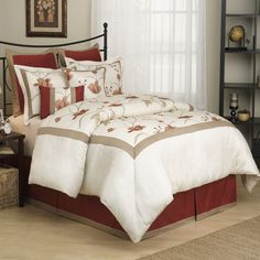This eight-piece floral comforter set will bring life, color, and elegance into your guest room or master bedroom. The oversized pattern features two-toned leaves and red flowers. The set includes a comforter, bedskirt, shams, and decorative pillows.