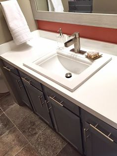 Modern sink and vanity, wall paper, painted counter, brushed nickel faucet C2design www.c2designinteriors.com