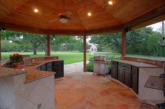 Outside covered summer kitchen that adjoins the pool and is the perfect setting for barbecues.