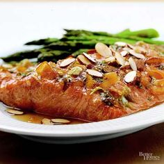 Orange juice gives this maple-glazed salmon a hint of fresh, zesty sweetness. Drizzle pecan glaze over the broiled bourbon salmon to complete this flavorful seafood recipe. Poached Salmon, Salmon And Asparagus, Steamed Salmon Recipes, Bourbon Glazed Salmon, Seafood Recipes, Cooking Recipes, Swordfish Recipes, Relish Recipes, Grilled Salmon
