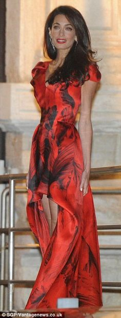 At the pre-wedding dinner Amal wore a red printed Alexander McQueen dress 2014..... THIS IS GEORGE CLOONEY'S WIFE!!!