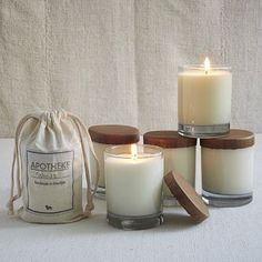 "Apotheke Candles Soothing scents. Apotheke scented candles are hand poured in Brooklyn from pure soy and essential oils. Beeswax-dipped wicks help these calming scents burn cleanly.Hand-poured soy wax.   3.1""diam. x 4""h.   Glass jar; comes packed in a muslin bag.   Scents: Basil Citrus, Honeysuckle, Ocean Rain, Woods, Ginger Green Tea, Vanilla Spearmint.   65 hour burn time.   Made in the USA. THB1057.00"