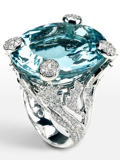 Miss Dior Ring in 18k White Gold with Diamonds and an Aquamarine | The large oval-cut aquamarine within an openwork foliate mount pavé-set with brilliant-cut diamonds, aquamarine approx 54.00 carats, diamonds approx 2.00 carats total