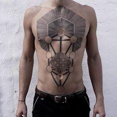 Geometrical chestpiece tattoo by Maxime Buchi