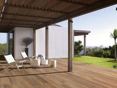 """Ever thought Patios could be done out of wood tile? Here is an explanation of wood tile used for a patio done out of our line called """"Travel."""" A rough finished wood tile is perfect for an outside use for porcelain tile. Outdoor Wood Tiles, Patio Tiles, Balcony Tiles, Outdoor Spaces, Indoor Outdoor, Outdoor Living, Outdoor Decor, Wood Like Tile, Ceramic Tile Bathrooms"""