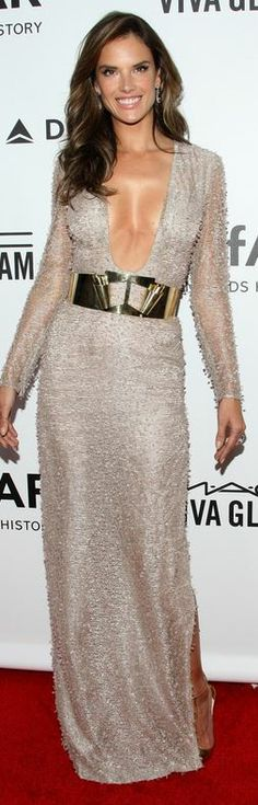 Who made Alessandra Ambrosio's jewelry and nude long sleeve gown that she wore in Los Angeles on December 12, 2013?