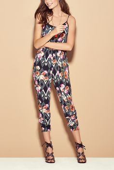 Love how this printed jumpsuit can easily transition from a day look to a night look.