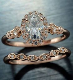 14kt Pink halo Engagement set with a 7x5 oval Moissanite
