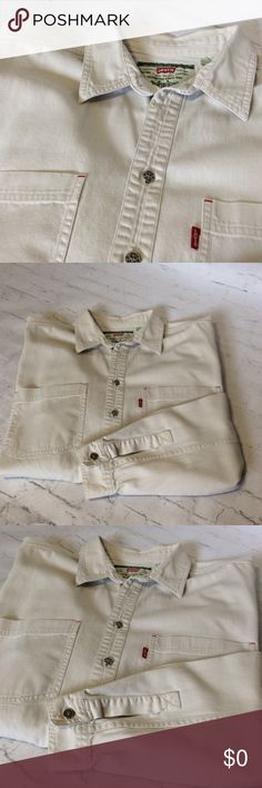 Men's Levi's Denim Button Down Men's Levi's Denim Button Down - light khaki in color -  Longsleeve - two pocket front - red tab on left front pocket - all buttons have the signature Levi's impression - 100% cotton Levi's Shirts Casual Button Down Shirts