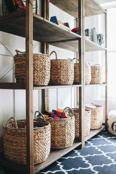 Using baskets to organize toys in a playroom. Organize a playroom that provides a calm atmosphere and promotes more creative play. We're sharing did just that with the toys in our playroom. Home Design, Design Ideas, Toy Room Organization, Baby Playroom, Playroom Closet, Office Playroom, Playroom Shelves, Children Playroom, Children Toys