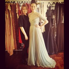 "Emmy Rossum got to ""play dress-up"" with designer Jenny Packham and tried on some gowns from her recent runway collection."