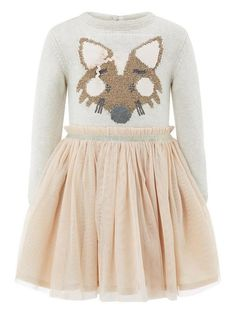 Our Alexia Fox dress for baby girls creates the look of a jumper and skirt thanks to its cosy knitted bodice. Fashioned in cotton, it showcases a beautiful fox motif in shimmering metallic threads, and is layered with pretty tulle from the waist atop a shimmering cotton lining. It boasts a stretch waistband, along with a button and keyhole to the back.Material Content: Outer Bodice: 98% Cotton 2% Other Outer Net Skirt: 100% PolyesterWashing Instructions: Machine Washable