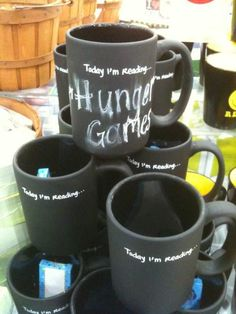 """Today I'm Reading…"" mugs. Pretty cool, too."