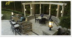 An outdoor kitchen and dining area highlight this patio.
