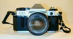 Canon AE-1 Program 35mm SLR Camera FD Canon Lens 50 mm 1:1.8 Lens With Black Strap
