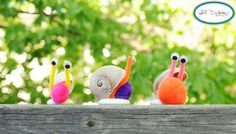 Sea shell snails.  1. glue the bottom of your seashell to your smooth bottomed stone. This will give it something to stabilize it.  2. glue a small pom pom on the stone coming in close contact with the shell  3. cut a piece of pipe cleaner to the desired length, bend it in a 'U' shape, put some glue on it and slip it between the shell and pom pom. Allow to dry.  4. glue some googly eyes to each antennae