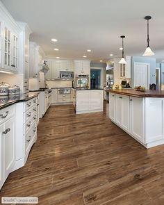 "This is porcelain tile made to look like wood flooring. South Cypress  - American Heritage 9"" x 36"" - Saddle"