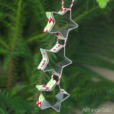 This ornament with three mini star cookie cutters strung together puts a twist on the expected star design, transforming it into a shooting star.