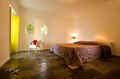 Built-Bed-Built-Consoles-Beautiful-Tiles-Hotel-Bedroom-Armchair-Yellow-Candles-Starfish-Holidays-Honeymoon-Santorini-Greece