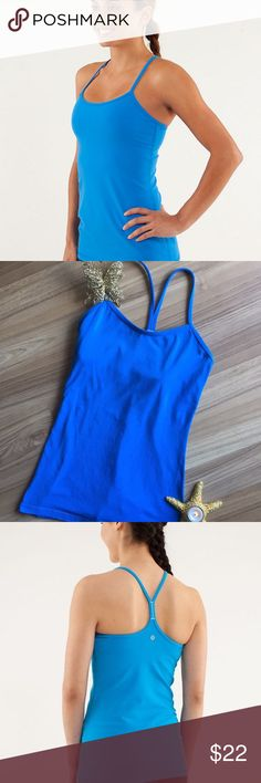 🍋 Lululemon Power Y Pipe Line Blue Tank EUC 🍋 🍋 Extra long 6, bra shelf, no nubbing, no pads just a great classic well designed tank useful for all activities! ( no size tag or dot, but it is a snug 6) NOTE: Accurate color is what the models show; my photos are darker than the true color. lululemon athletica Tops Tank Tops