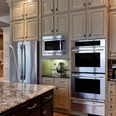 Light brown cabinets with stainless steel appliances? AMAZING!!