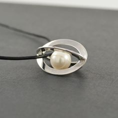 Caged Pearl Pendant in sterling silver | Buy sterling silver jewellery with a difference online at Crowded Silver  #pearl necklace #jewellery silver jewellery